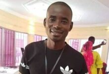 Photo of Gambian Reporter In Custody for Filming Arrest of Drivers